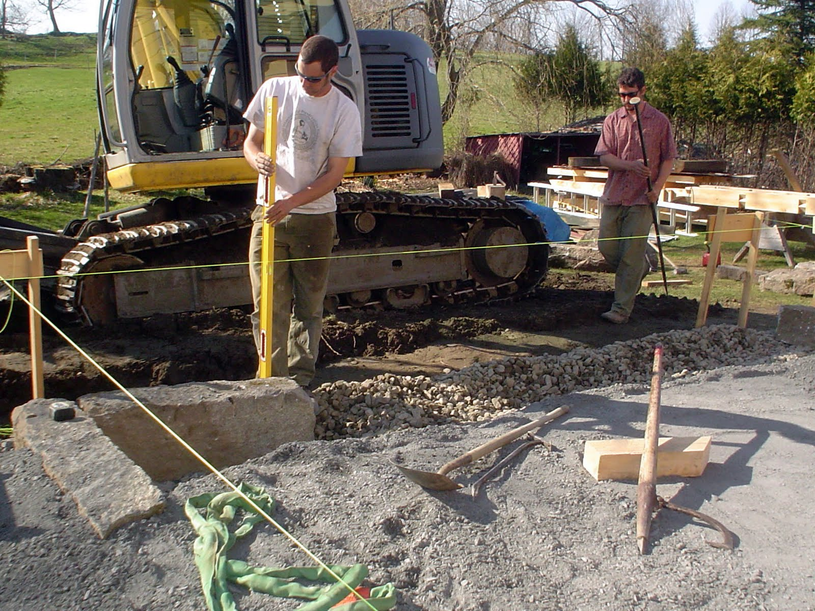 A granite foundation from a barn that had burned down on the property was scattered in a field across the road.  We retrieved the granite for the new foundation.