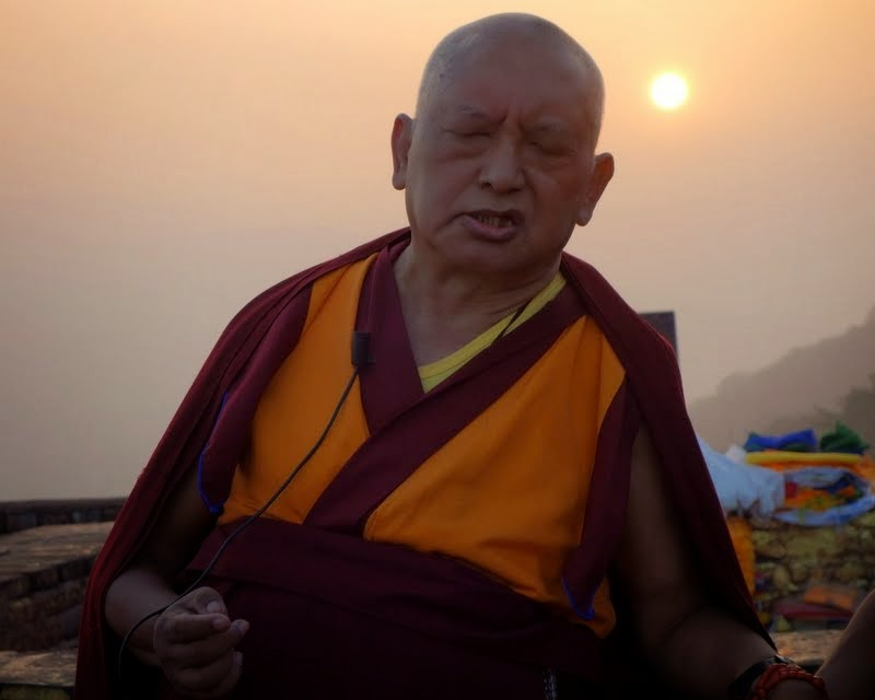 As the sun starts to set on Rajgir, Lama Zopa Rinpoche's teaching continues, February 2014. Photo by Ven. Roger Kunsang.