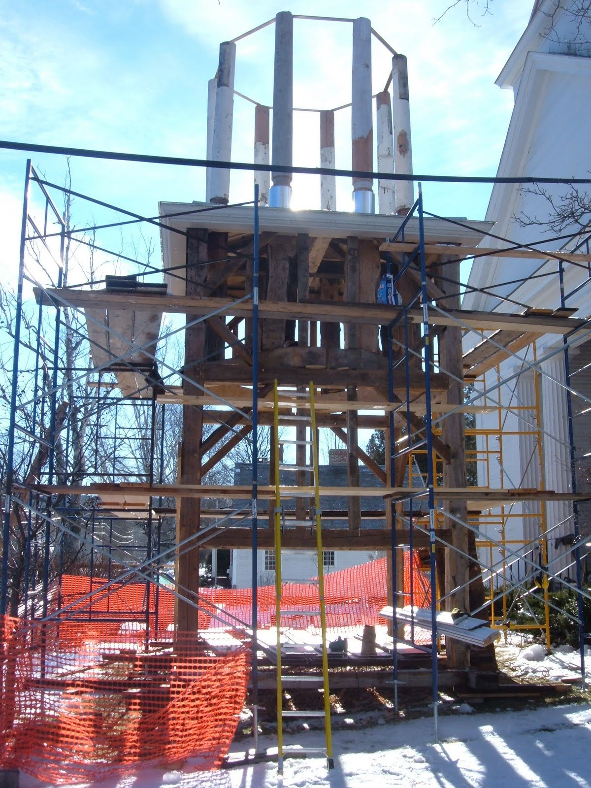 The restored upper tower, columns and cornice mouldings prior to boarding.