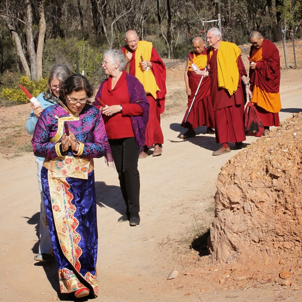 Lama Zopa Rinpoche being led to the long life puja in the Great Stupa of Universal Compassion by (from right) Khen Rinpche Geshe Chonyi, FPMT CEO Ven. Roger Kunsang, Thubten Shedrup Ling director Gyatso, FPMT Board of Directors secretary Paula de Wys-Koolkin, FPMT Australia coordinator Helen Patrin and FPMT Center Services director Claire Isitt, Australia, September 19, 2014. Photo by Laura Miller.