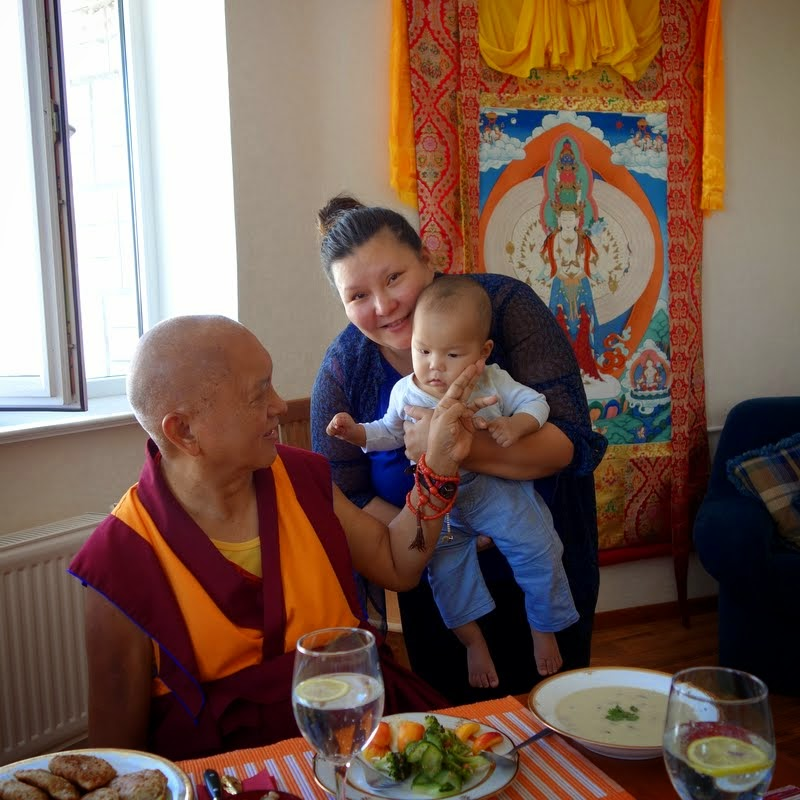Lama Zopa Rinpoche blessing baby, Ulaanbaatar, Mongolia, August 2014. Photo by Ven. Roger Kunsang.