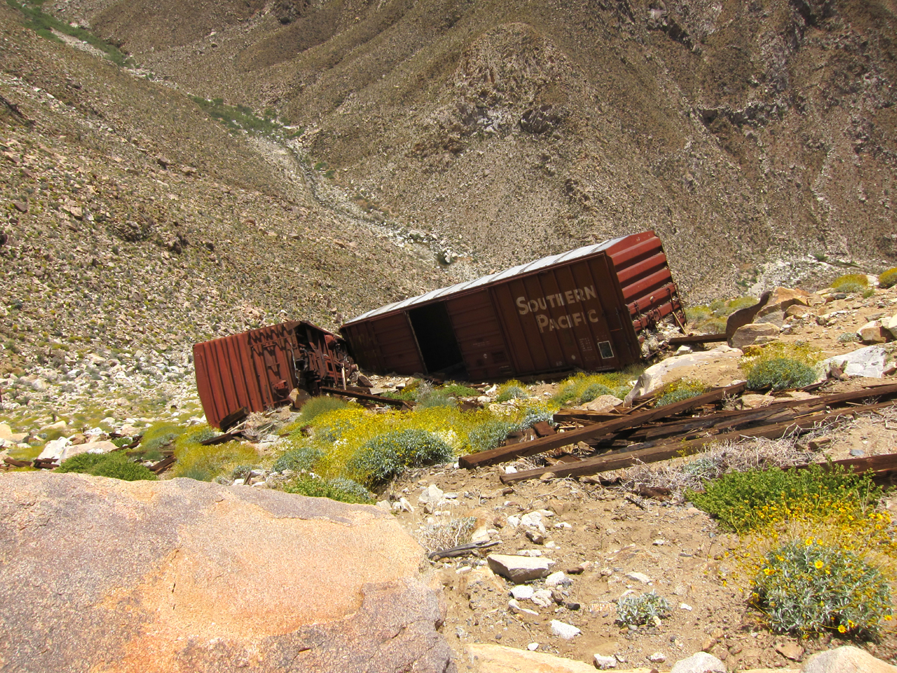 Old box cars that were apparently pushed off the mountain