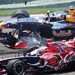 Vitantonio Liuzzi (ITA/ Scuderia Toro Rosso) and Christian Klien (AUT/ Red Bull Racing) in action involved in a crash