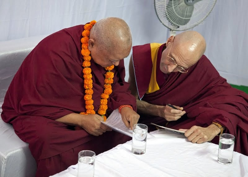Lama Zopa Rinpoche with Ven. Kabir Saxena preparing remarks for Maitreya Project Foundation Stone Laying Ceremony, Kushinagar, India, December 13, 2013. Photo by Andy Melnic.