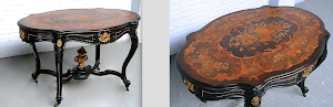 Антикварный стол овальной формы. 19-й век. Маркетри с цветочным узором, чёрный лак, позолоченная бронза.