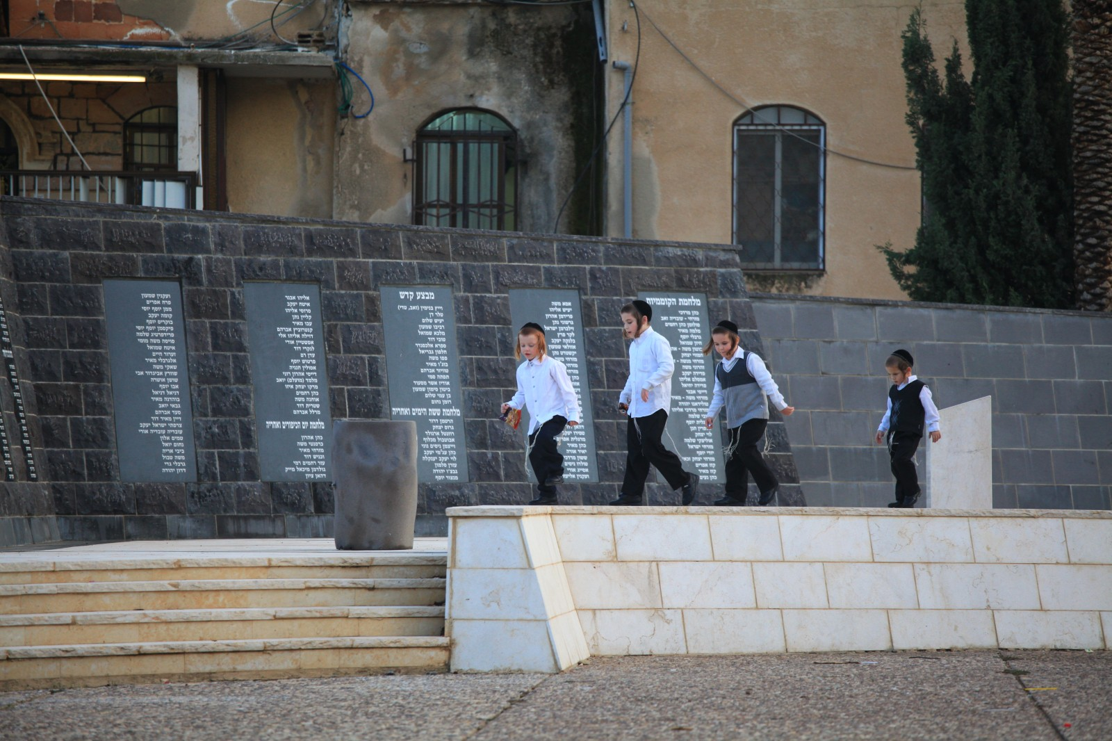 Properly dresses Jewish boys - with payots (sidelocks) and those funny strings hanging from their shirts