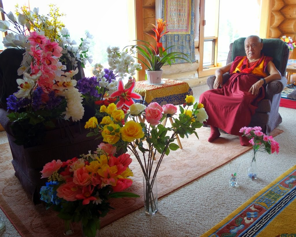Lama Zopa Rinpoche with some of the flowers for offering, Buddha Amitabha Pure Land, Washington, US, April 2014. Photo by Ven. Roger Kunsang.