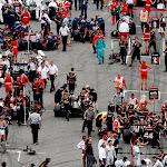 The Lotus team prepare their F1 cars