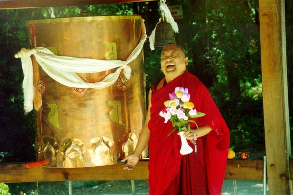 Lama Zopa Rinpoche at Land of Medicine Buddha prayer wheel.
