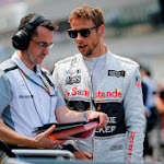 Jenson Button speaks to his engineer before the race.
