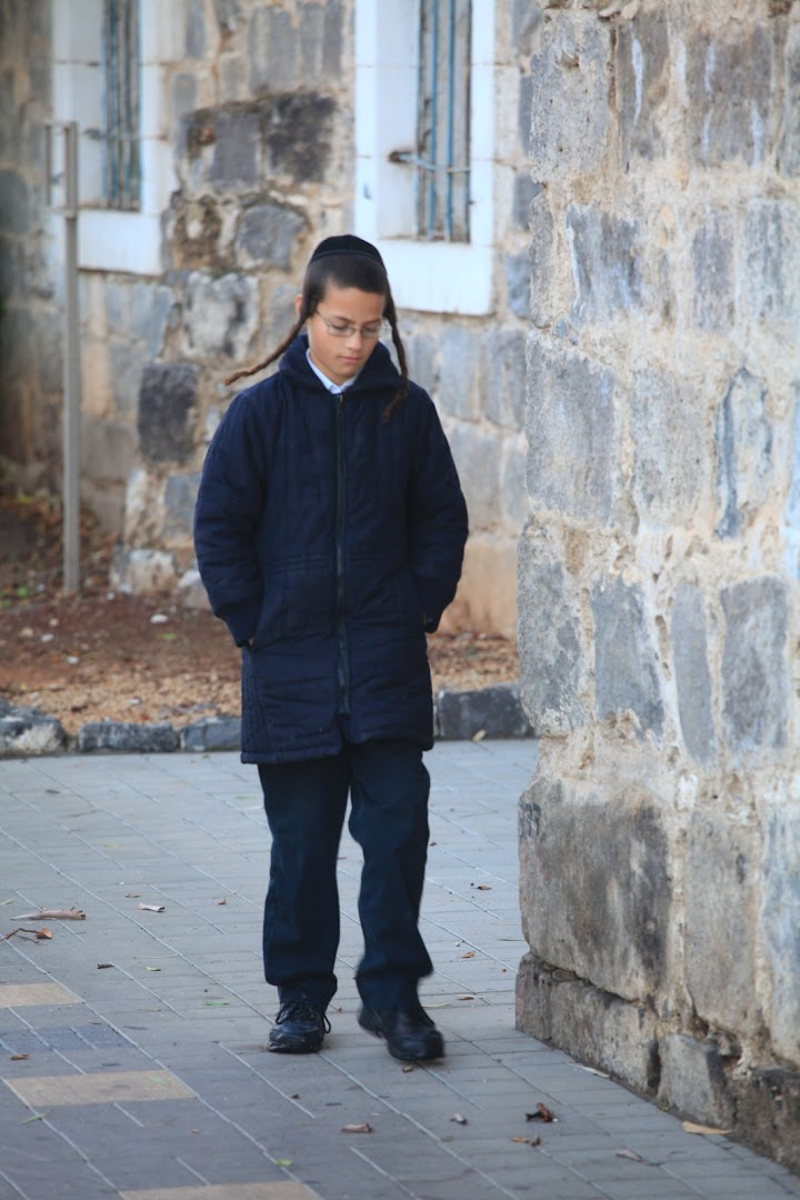 Lonely Jewish boy during Shabbat