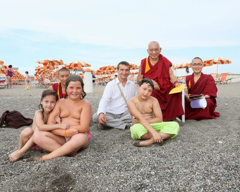 Lama Zopa Rinpoche, Fabrizio Pallotti and Vens. Sangpo and Sherab joined by Italian children on the beach. Rinpoche traveled to the coast to bless all of the sentient beings in the water, Italy, June 11, 2014. Photo by Ven. Thubten Kunsang.