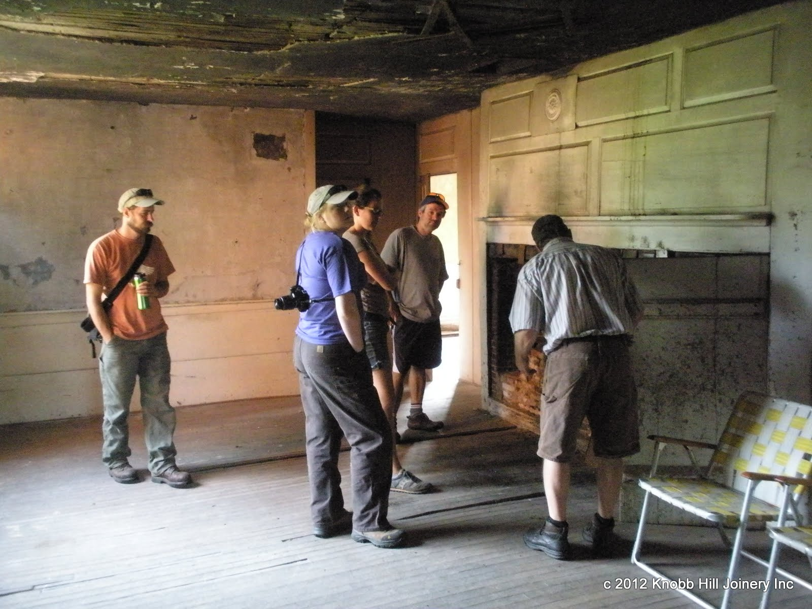 Jamie Duggan explains historic masonry at the Theron Boyd House.