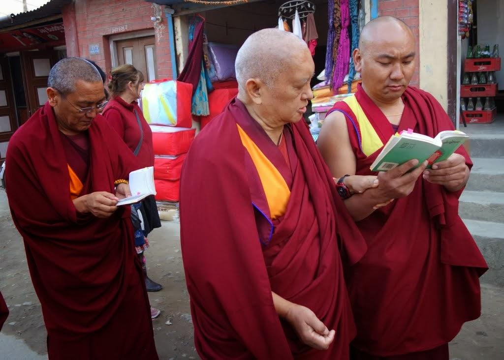Lama Zopa RinpochecircumambulatingSwayambhuStupa while reading the Vajra Cutter SutrawithKopan abbot KhenRinpocheGesheChonyi and others,Kathmandu, Nepal, November 24, 2013.Photo byVen. RogerKunsang.