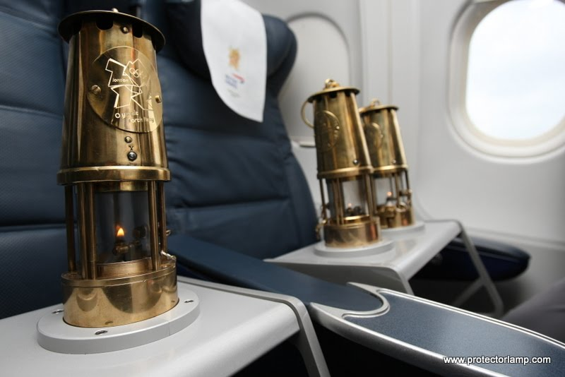 The Olympic flame is secured into seat 1a and 1b for the flight back to the UK.