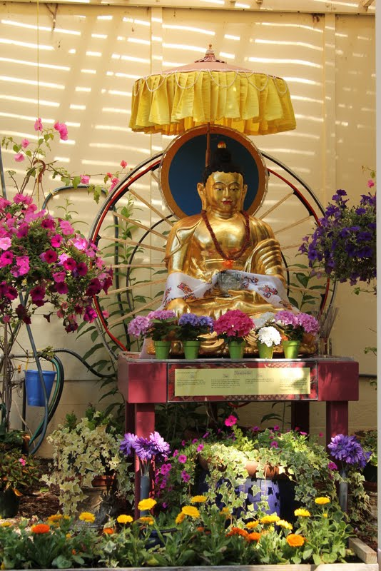 Buddha and flower offerings at Kachoe Dechen Ling