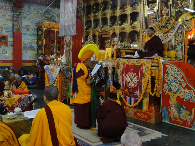 Lama Zopa Rinpoche offering mandala to His Holiness the Sakya Trizin, at the commencement of the Wangya Norbu Tangwa initiations, Dheradhun, India 2010