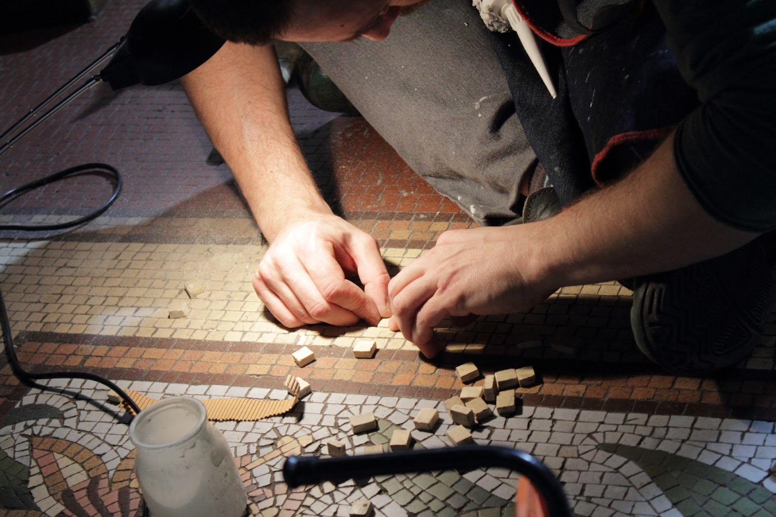 Metropolitan Cathedral - painstakingly fixing the broken tile murals