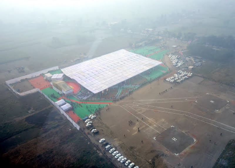 Aerial view of ceremony site and Maitreya Project land, Kushinagar, India, December 13, 2013. Photo by Ven. Roger Kunsang.