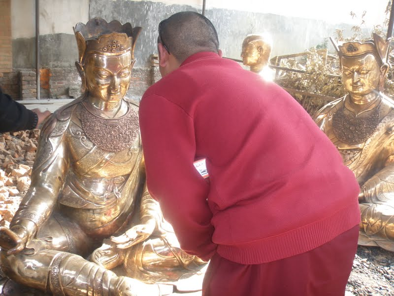 Checking the progress of the Padmasambhava statues for Lawudo