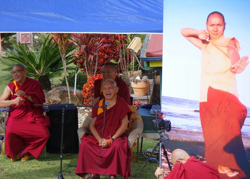 Lama Zopa Rinpoche with Geshe Jamyang and Geshe Phuntsok (resident geshe at Chenrezig Institute) next to a life-sized poster of Lama Yeshe during Chenrezig Institutes 40th anniversary celebration, Australia, September 2014. Photo by Ven. Roger Kunsang.