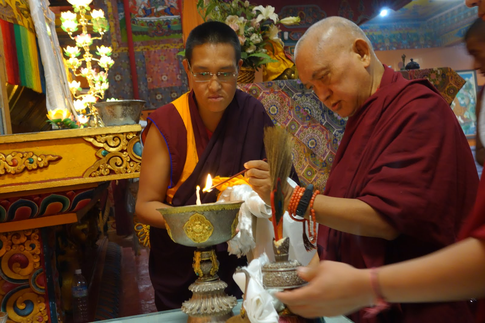 Rinpoche lighting a large butter lamp in Kopan gompa after arriving from the airport to Kopan. Rinpoche did 3 long prostrations and then katha offering the main statues including the Lama Yeshe statue. Photo by Ven. Roger Kunsang
