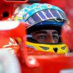 Fernando Alonso sitting in his Ferrari F14T
