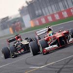 Kimi Raikkonen gets passed by Felipe Massa