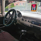 With modern, but not working stereo system, engine from 1980s Mercedes from Venezuela