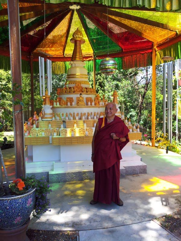 Lama Zopa Rinpoche in front of Kadampa stupa at Kachoe Dechen Ling, Aptos, CA