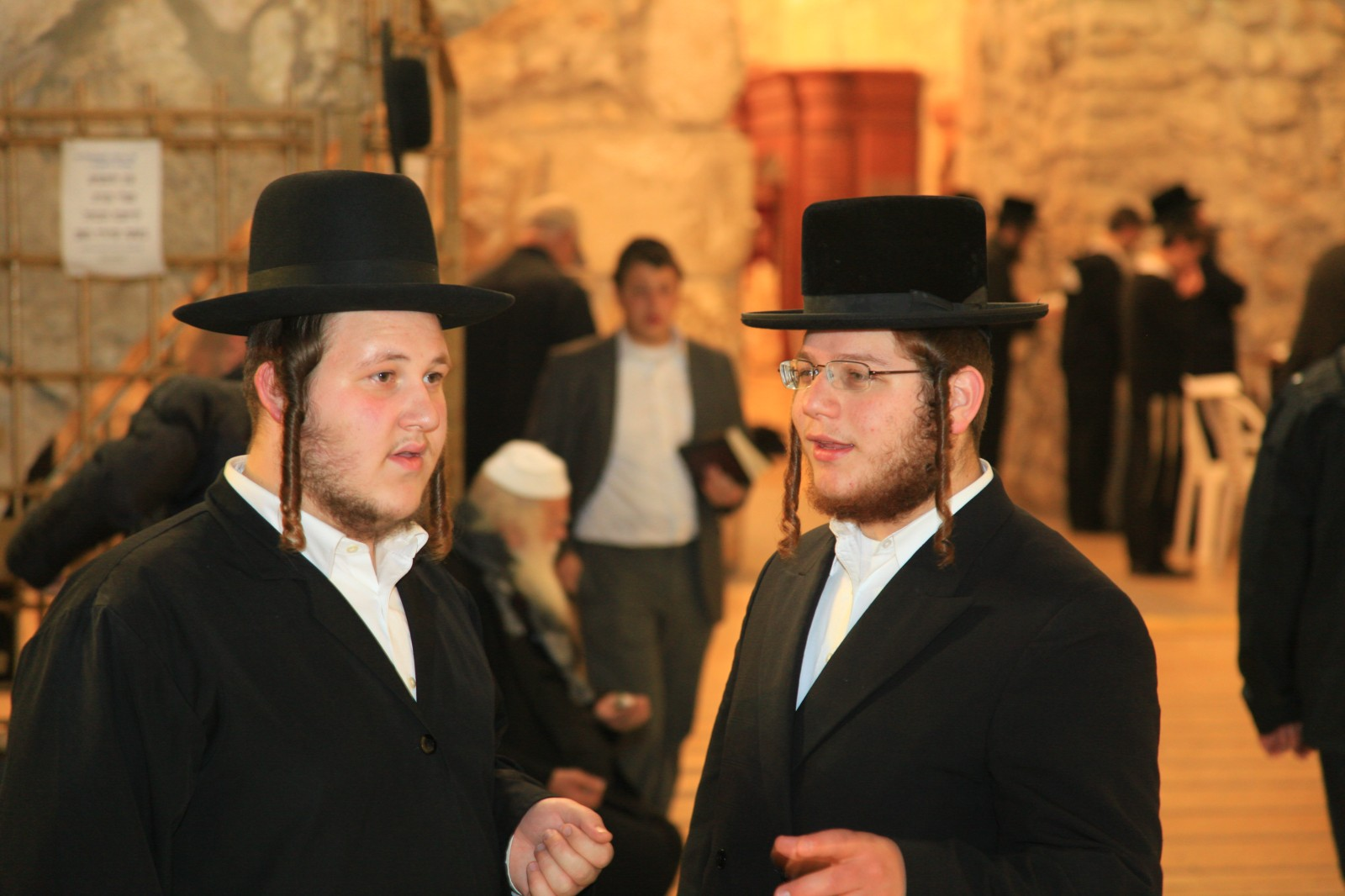 The Torah said that you should not cut off hair next to your ears. Proper Jews follow this advice resulting in stylish sidelocks called Payot