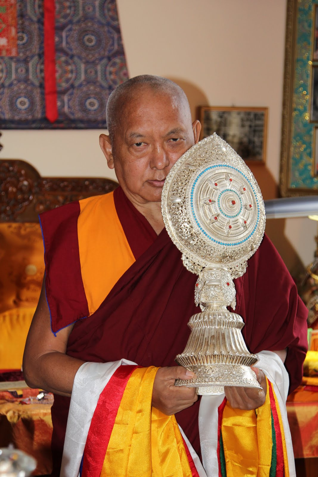 Rinpoche offers a silver Dharma Chakra to His Holiness the Dalai Lama during his visit to FPMT International Office- 6,000 miles away in Portland! Photo by Ven. Roger Kunsang.