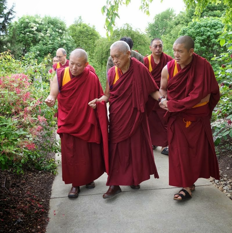 Lama Zopa Rinpoche strolling in park with (left) Geshe Tenley, resident geshe at Kurukulla Center, and (right) Geshe Gelek Chodha, resident geshe at Kadampa Center, Raleigh, North Carolina, US, May 2, 2014. Photo by Ven. Roger Kunsang.