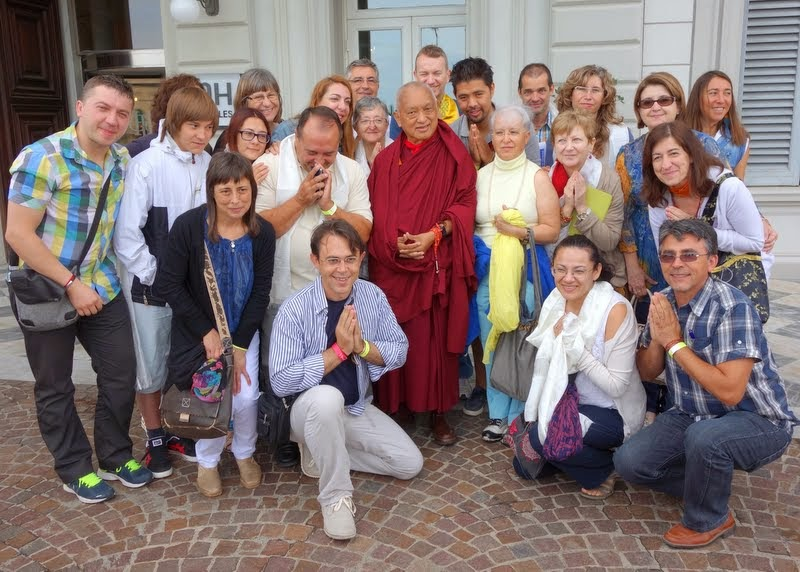Lama Zopa Rinpoche and some Spanish students after seeing His Holiness off from his hotel, Livorno, Italy, June 15, 2014. Photo by Ven. Roger Kunsang.