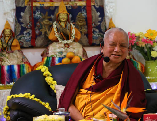 """Lama Zopa Rinpoche during public talk """"Transforming Problems into Happiness,"""" Bangalore, India, January 9, 2015.  Photo by Ven. Thubten Kunsang."""