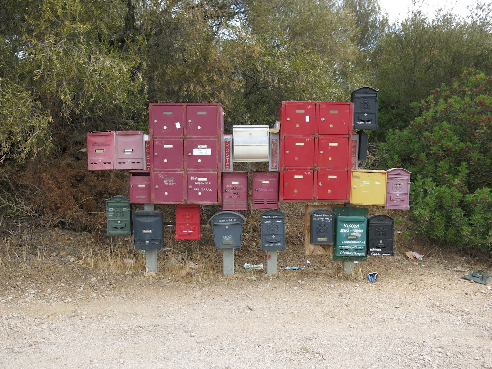 It seems everyone is running a B&B on Sardinia, so the mailman gets a break by centralising these typical red mailboxes at the beginning of many of the unpaved roads.