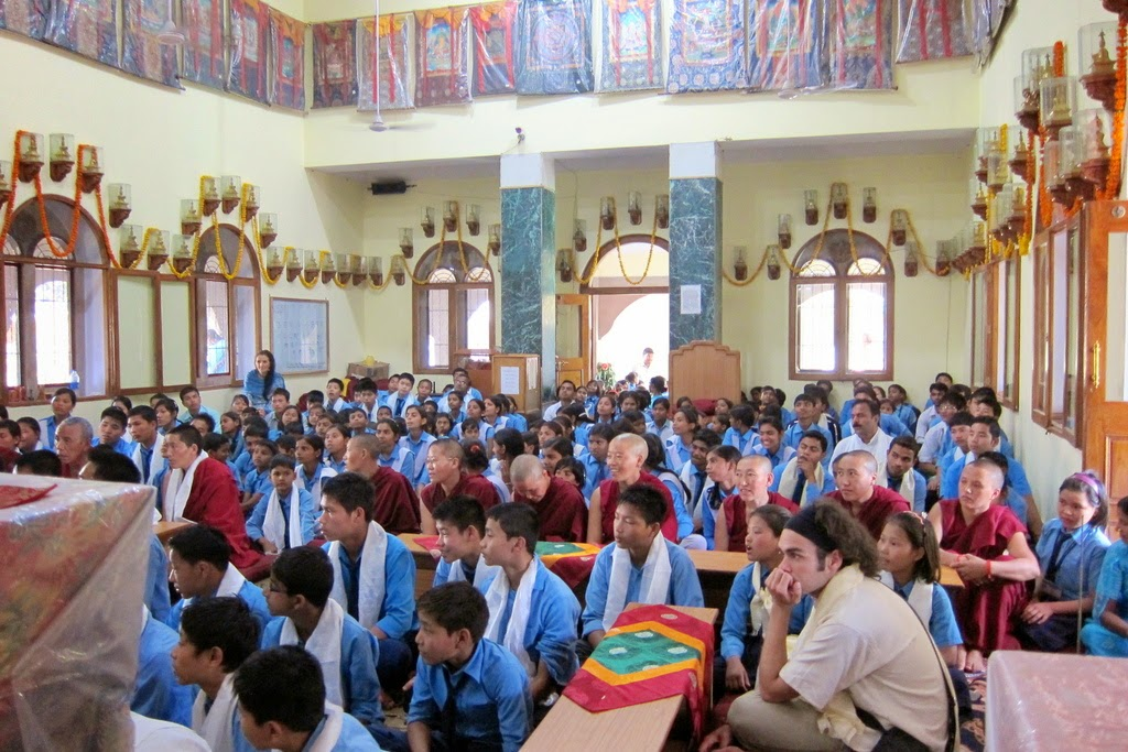 Nuns from Tara Nunnery and children from Alice Project Universal Education School listening to Rinpoche teach, Sarnath, India, March 2014. Photo by Ven. Sarah Thresher.