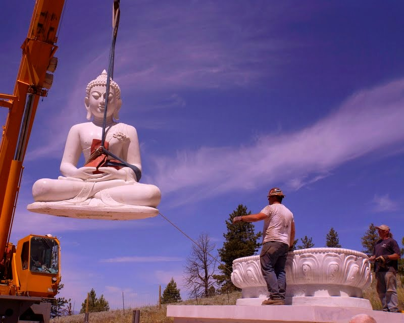 Moving the Amitabha Buddha statue on to the lotus throne, Buddha Amitabha Pure Land, Washington, US, July 1, 2014. Photo by Merry Colony.