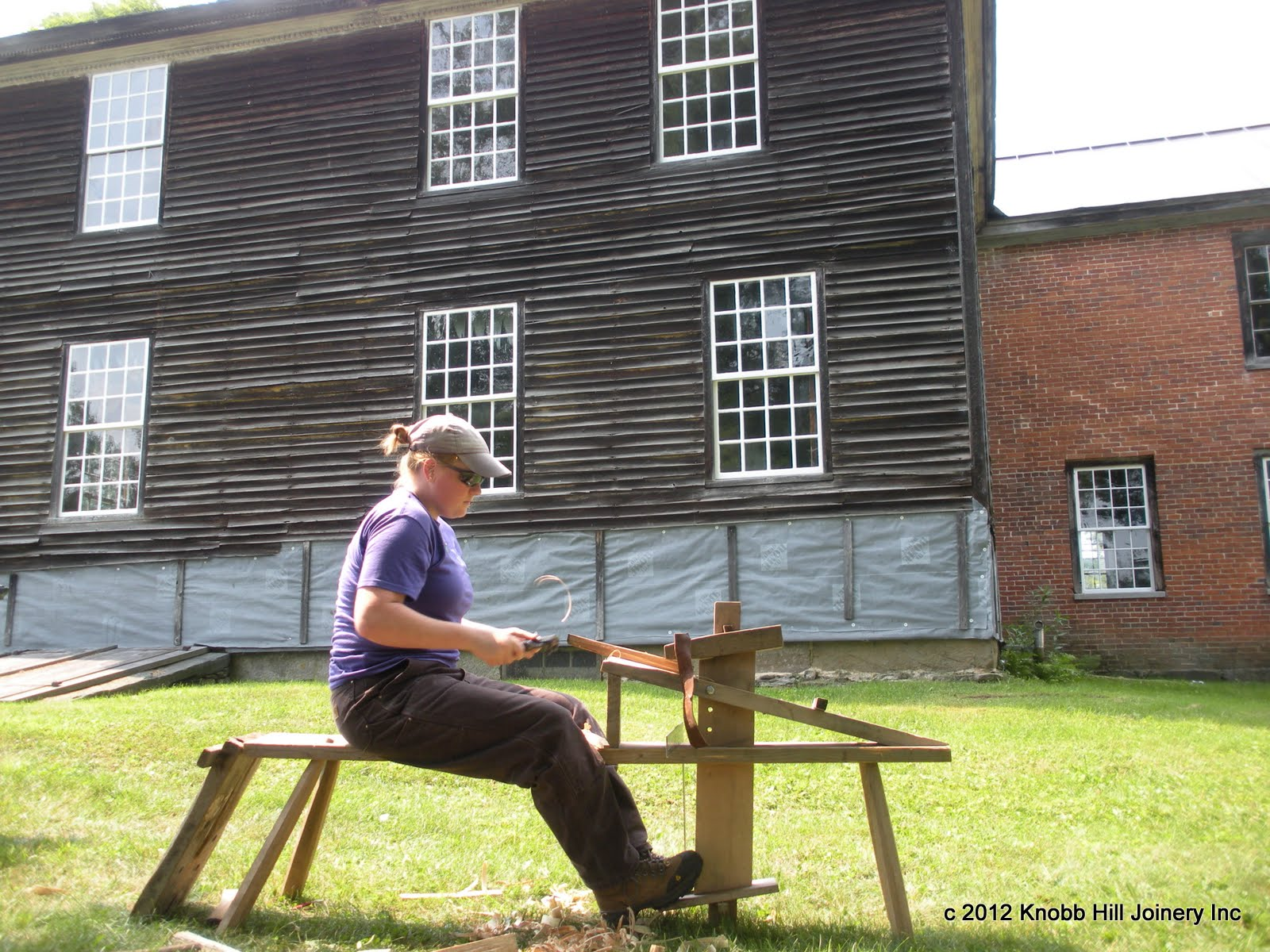 A Yestermorrow student shapes a peg at the Theron Boyd house.