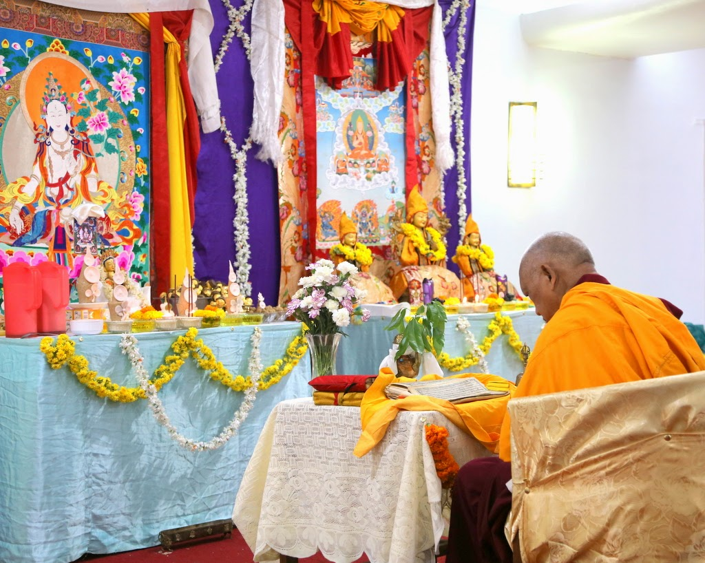 Lama Zopa Rinpoche doing preparations for White Tara initiation in Bangalore, India, March 2014. Photo by Ven. Thubten Kunsang.