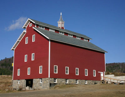 Restored west monitor with local clapboards and slate roofing.