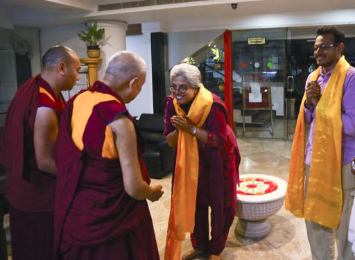 Rinpoche arriving at public talk organized by Choe Khor Sum Ling, Bangalore, India, January 2015. Photo by Ven. Thubten Kunsang.