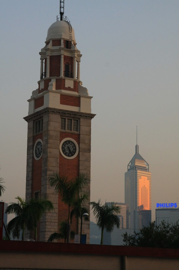 One of the very few preserved historic buildings in Hong Kong - the bell tower in Kowloon, overlooking the skyline of Hong Kong Island