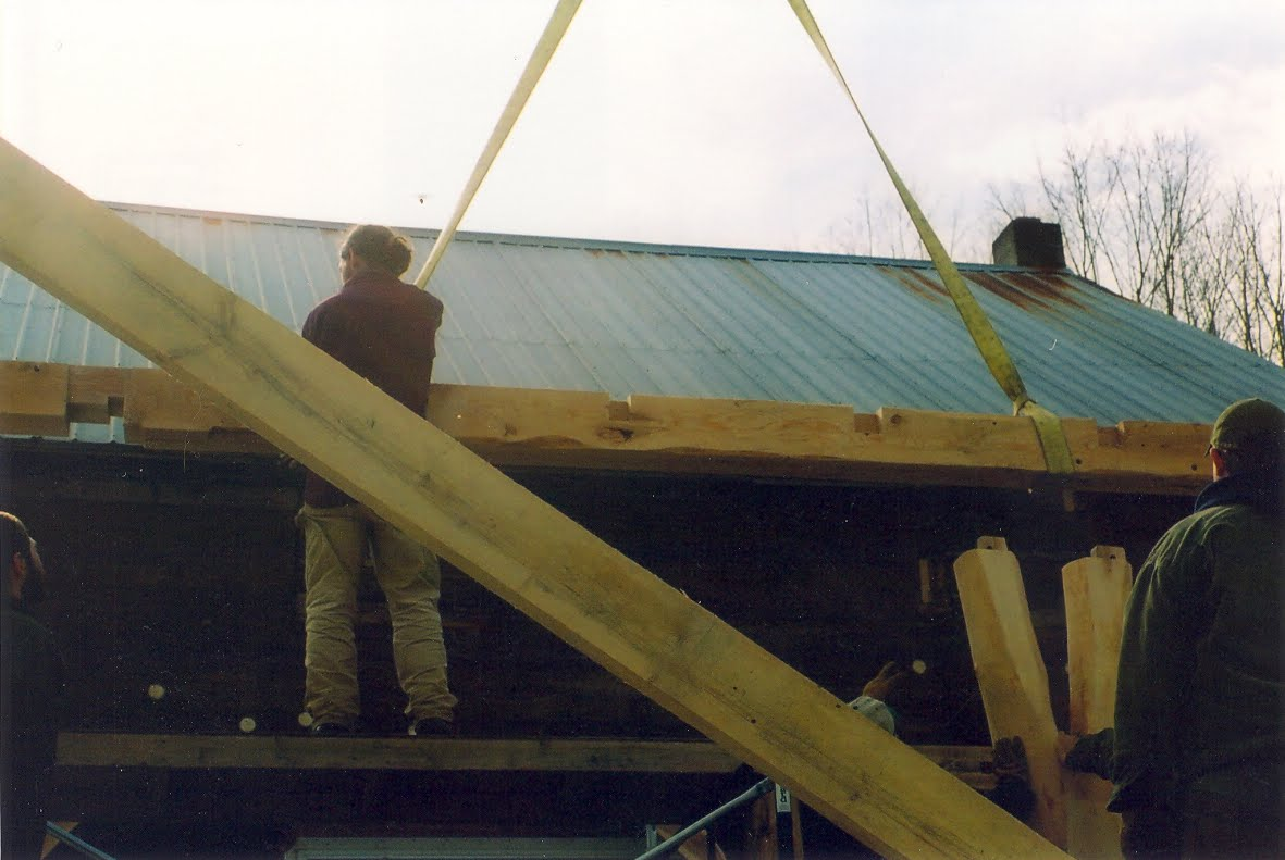 Tie beam with cog joinery that fits on top of the plate.