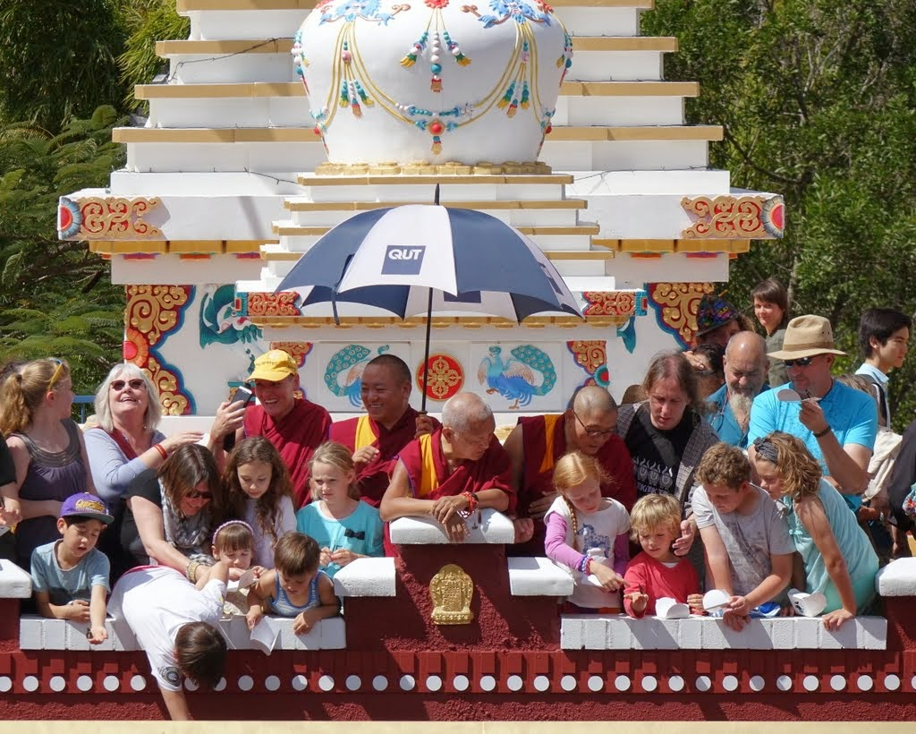 Lama Zopa Rinpoche with the children of Chenrezig Institute releasing butterflies during the 40th anniversary celebration, Eudlo, Queensland, Australia, September 2014. Photo by Ven. Roger Kunsang.