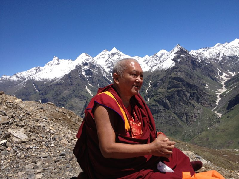Rinpoche in the center in Mongolia , with Mongolian jacket, has a little cold. 19 Aug 2013. Photo. Roger Kunsang
