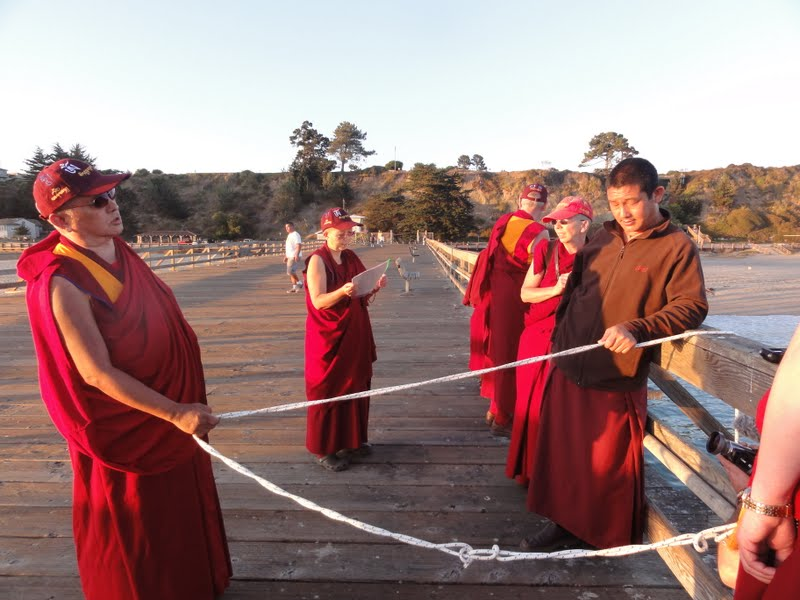 Rinpoche blessing the sentinet beings in the ocean