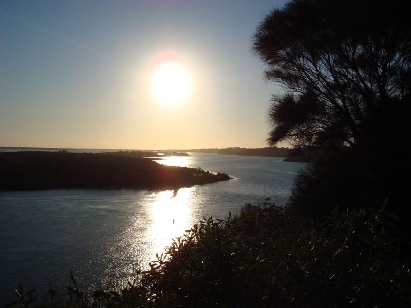 Sun setting over the Lakes Entrance waterways