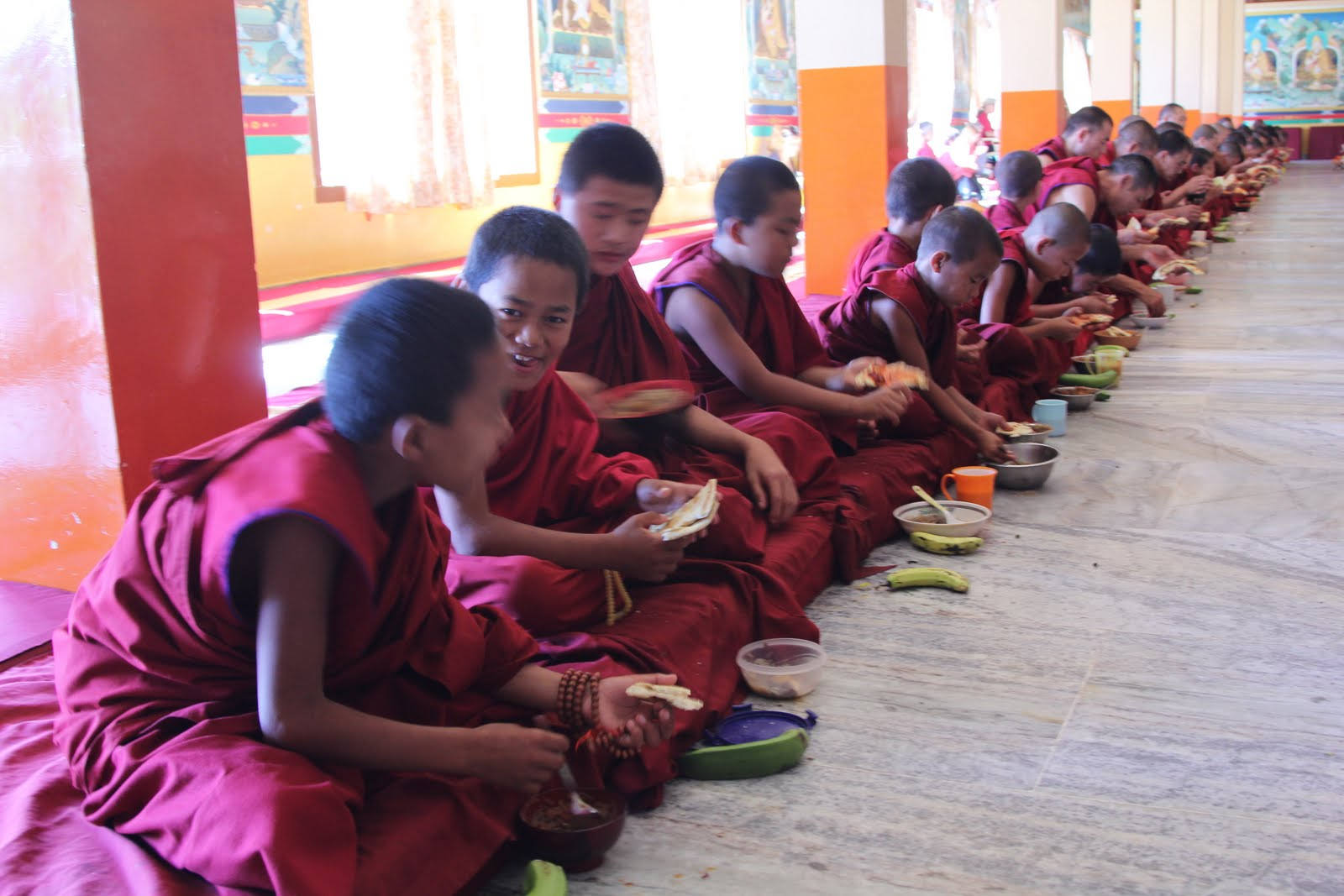 Small monks enjoying food