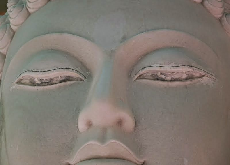 Before painting, Gelek had to reshape the statue's eyes to follow Rinpoche's advice, Buddha Amitabha Pure Land, Washington, US, August 2014. Photo by Ven. Roger Kunsang.